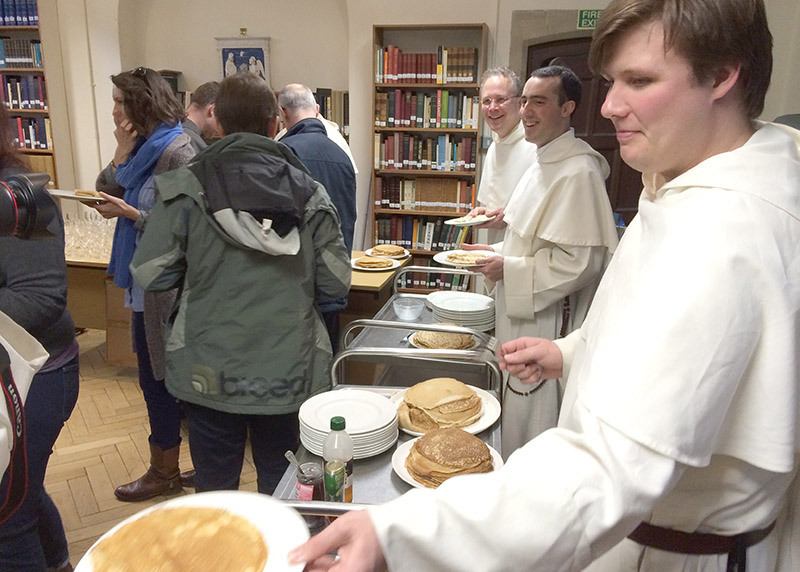 Br Samuel serving pancakes